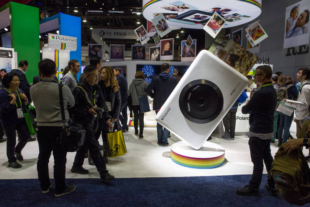 CES attendees walk around the Polaroid exhibit at CES in the Las Vegas Convention Center on Thursday, Jan. 11, 2018. Patrick Connolly Las Vegas Review-Journal @PConnPie