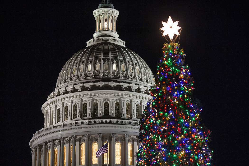 The Capitol Christmas tree is illuminated as lawmakers in the Senate work late into the evening on the Republican tax bill, in Washington, Tuesday, Dec. 19, 2017. (AP Photo/J. Scott Applewhite)