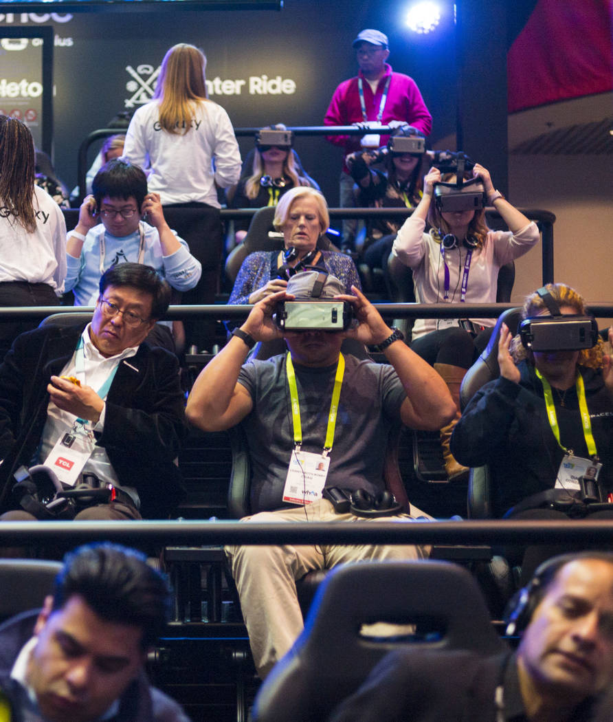 Attendees prepare to experience a virtual reality presentation by Samsung during CES at the Las Vegas Convention Center in Las Vegas on Friday, Jan. 12, 2018. Chase Stevens Las Vegas Review-Journa ...