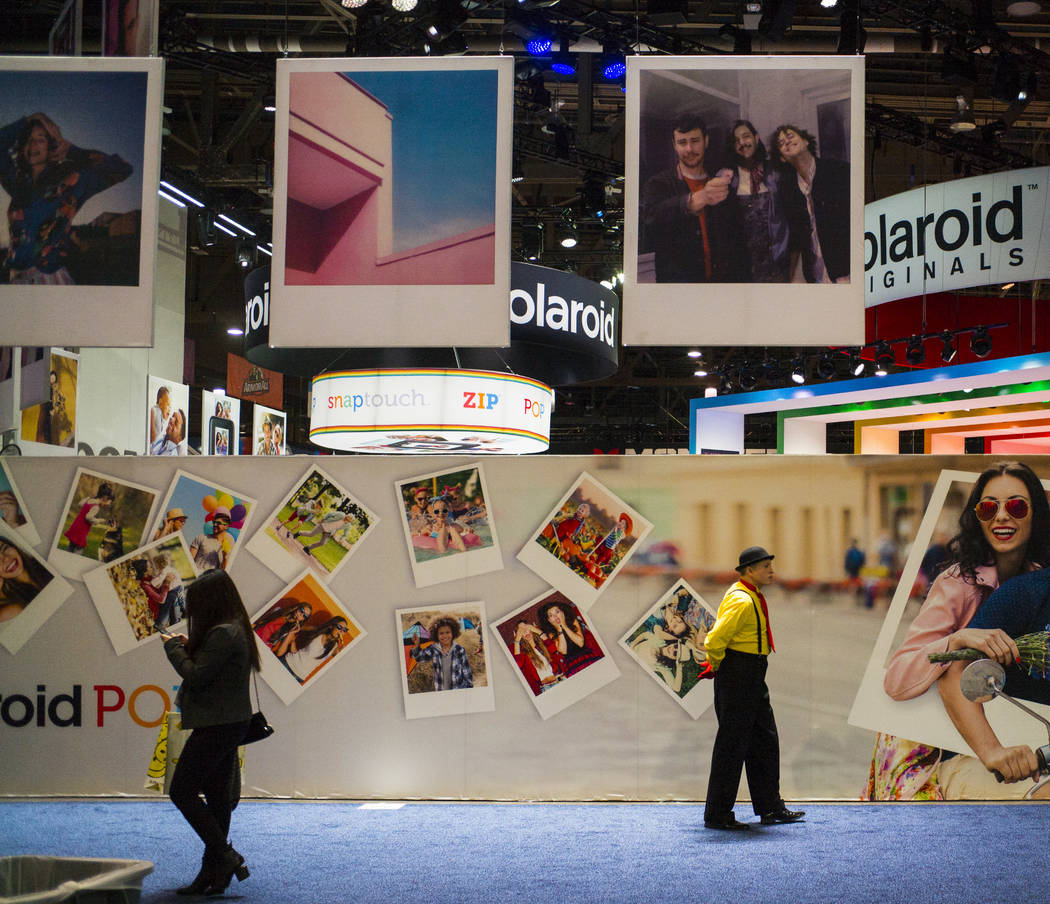 Attendees pass by the Polaroid booth during CES at the Las Vegas Convention Center in Las Vegas on Friday, Jan. 12, 2018. Chase Stevens Las Vegas Review-Journal @csstevensphoto