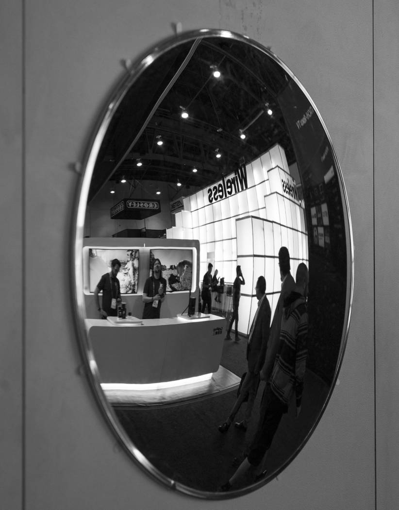 The show floor reflected in a mirror during CES at the Las Vegas Convention Center in Las Vegas on Friday, Jan. 12, 2018. Chase Stevens Las Vegas Review-Journal @csstevensphoto