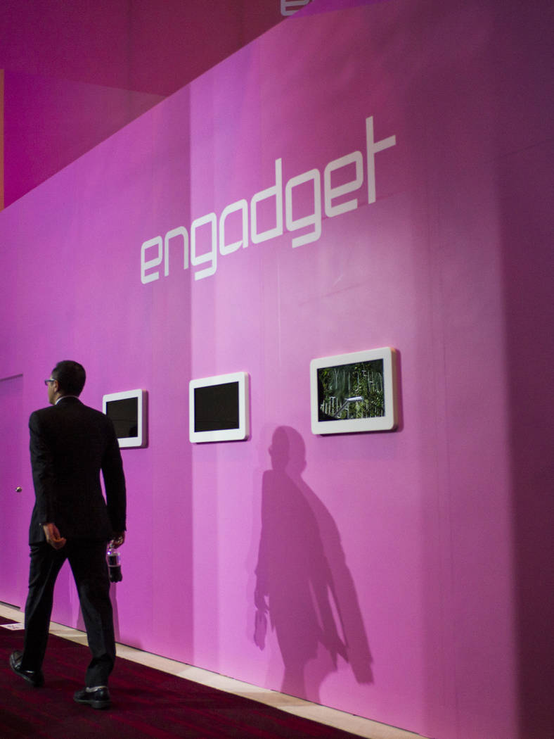 A man passes the Engadget booth during CES at the Las Vegas Convention Center in Las Vegas on Friday, Jan. 12, 2018. Chase Stevens Las Vegas Review-Journal @csstevensphoto
