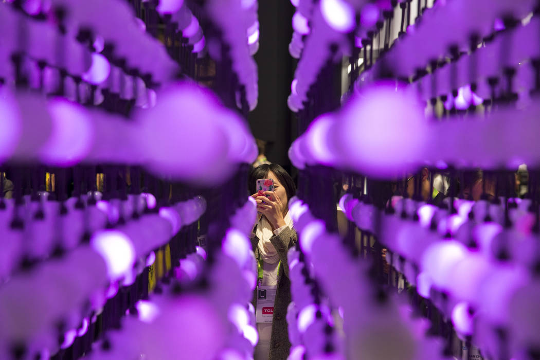 A woman snaps a photo LG's Nano Cell display at CES in Las Vegas on Friday, Jan. 12, 2018. Richard Brian Las Vegas Review-Journal @vegasphotograph