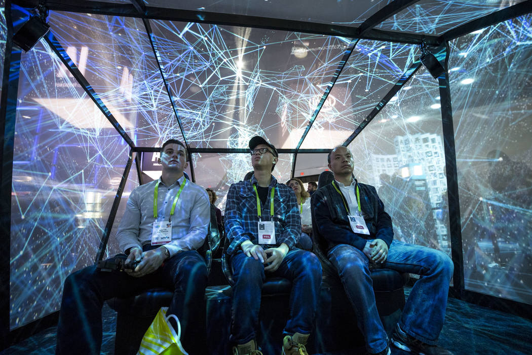 Attendee's take part in Intel's autonomous vehicle simulator at CES in Las Vegas on Friday, Jan. 12, 2018. Richard Brian Las Vegas Review-Journal @vegasphotograph