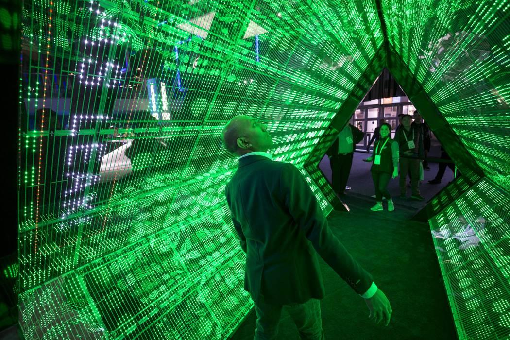 Prabhath Bakmiwewa of California walks through Intel's 5G tunnel simulator at CES in Las Vegas on Friday, Jan. 12, 2018. Richard Brian Las Vegas Review-Journal @vegasphotograph