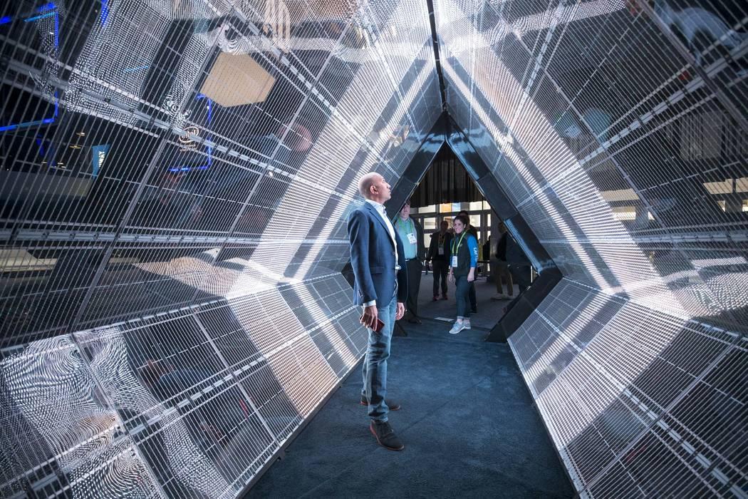 Prabhath Bakmiwewa of Califonia walks through Intel's 5G tunnel simulator at CES in Las Vegas on Friday, Jan. 12, 2018. Richard Brian Las Vegas Review-Journal @vegasphotograph