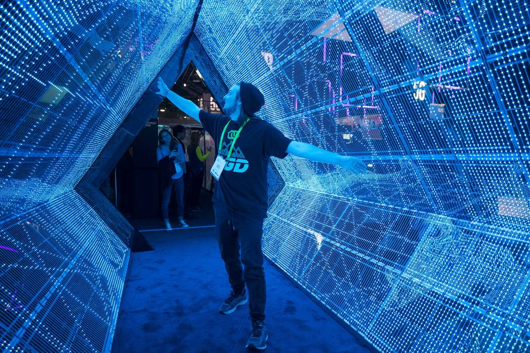 Keith Smith of Las Vegas walks through Intel's 5G tunnel simulator at CES in Las Vegas on Friday, Jan. 12, 2018. Richard Brian Las Vegas Review-Journal @vegasphotograph