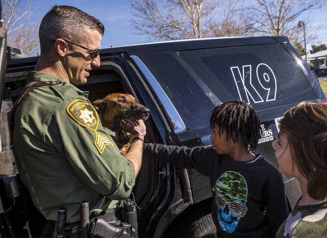 Sgt. Joshua Bitsko shows off his patrol service dog, Loki, to Elyjah Graham, 8, and Isaac Irizarry, 10, during a Law Enforcement Appreciation Day event at Police Memorial Park on Saturday, Jan. 13 ...