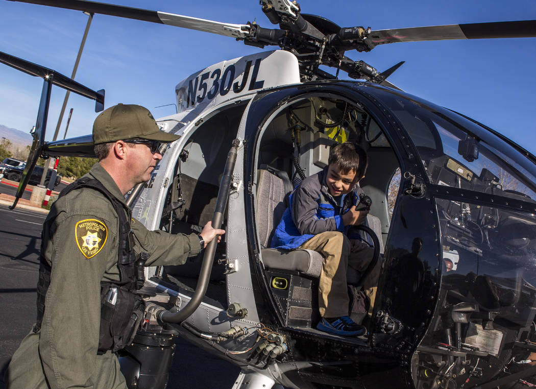 Harry DuBray III, 7, checks out a helicopter from the LVMPD Search and Rescue as rescue pilot David Brooks stands by during a Law Enforcement Appreciation Day event at Police Memorial Park on Satu ...