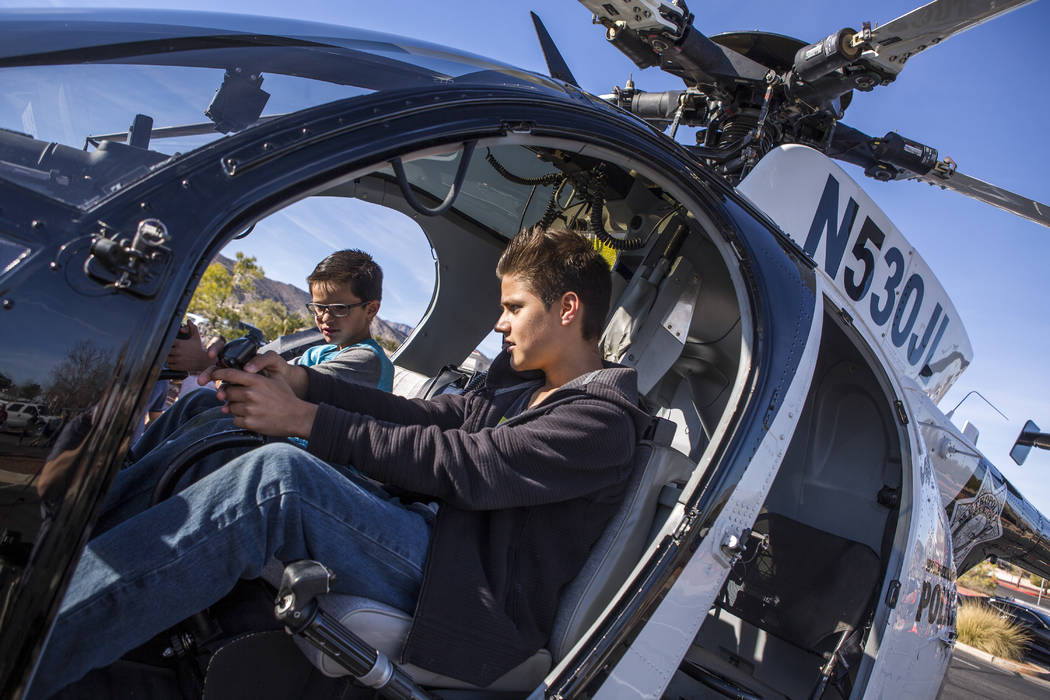Evan, 13, and Dominick Raugust, 9, check out a helicopter from the LVMPD Search and Rescue team during a Law Enforcement Appreciation Day event at Police Memorial Park on Saturday, Jan. 13, 2018.  ...