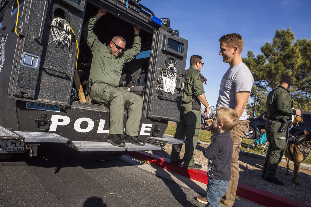 Miles, 3, and Spencer Gubler check out a LVMPD SWAT vehicle during a Law Enforcement Appreciation Day event at Police Memorial Park on Saturday, Jan. 13, 2018.  Patrick Connolly Las Vegas Review-J ...