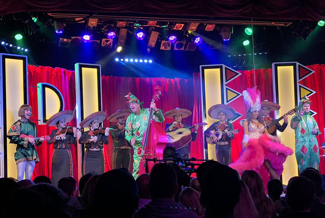 "Penn JIllette and Piff the Magic Dragon (aka John van der Put) are joined by Francis the Squire (Brett Alters) and Piff's showgirl sidekick Jade Simone during a performance of ""The Dragon's Song a ..."