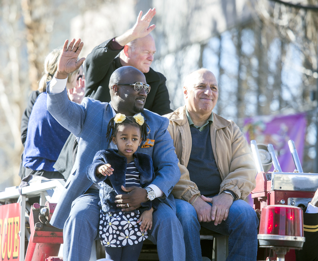 Las Vegas City Councilmen Ricki Barlow, left, Bob Beers and Stavros Anthony ride on top of a fire truck during the 35th annual Dr. Martin Luther King Jr. Parade in downtown Las Vegas on Jan. 16, 2 ...