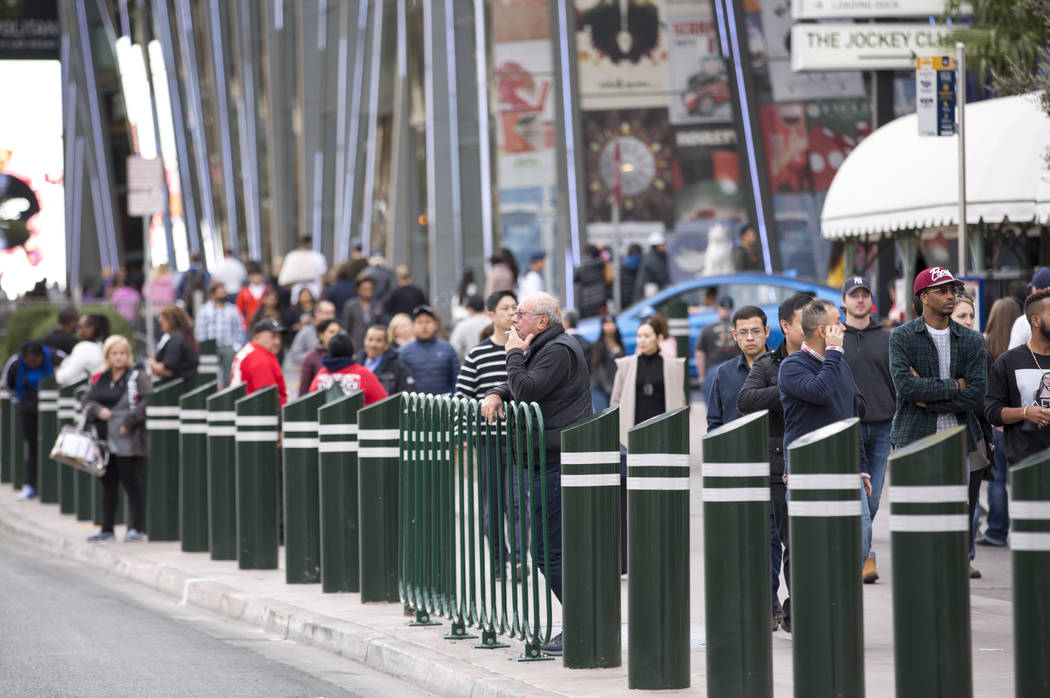 People walk past recently installed safety bollard on the Vegas Strip on Tuesday, January 2, 2018. Richard Brian Las Vegas Review-Journal @vegasphotograph