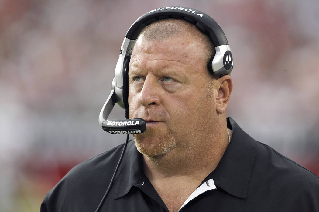 Former Oakland Raiders head coach Tom Cable paces the sidelines during an NFL football game against the Arizona Cardinals Sunday, Sept. 26, 2010, in Glendale, Ariz. The Cardinals defeated the Raid ...