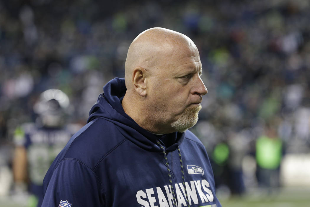 Seattle Seahawks assistant head coach Tom Cable walks on the field before an NFL football game against the Philadelphia Eagles, Sunday, Dec. 3, 2017, in Seattle. (AP Photo/Ted S. Warren)