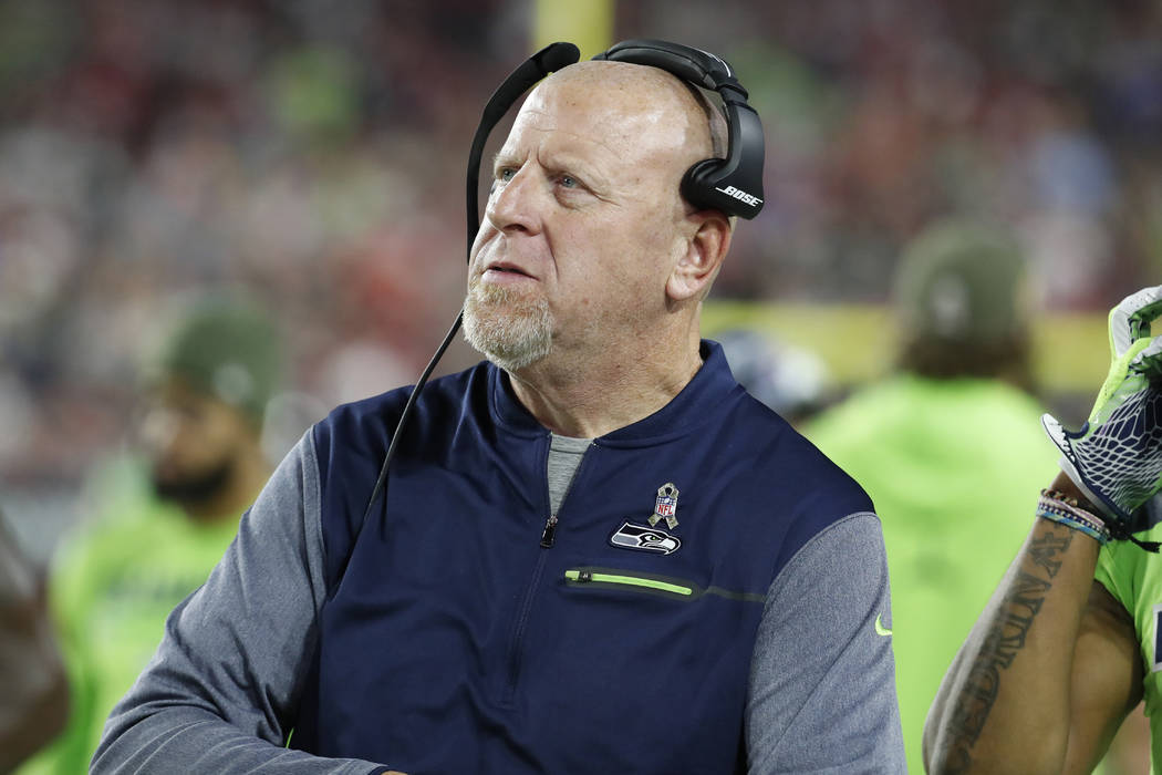 Seattle Seahawks assistant head coach Tom Cable walks the sidelines during the second half of an NFL football game against the Arizona Cardinals, Thursday, Nov. 9, 2017, in Glendale, Ariz. (AP Pho ...