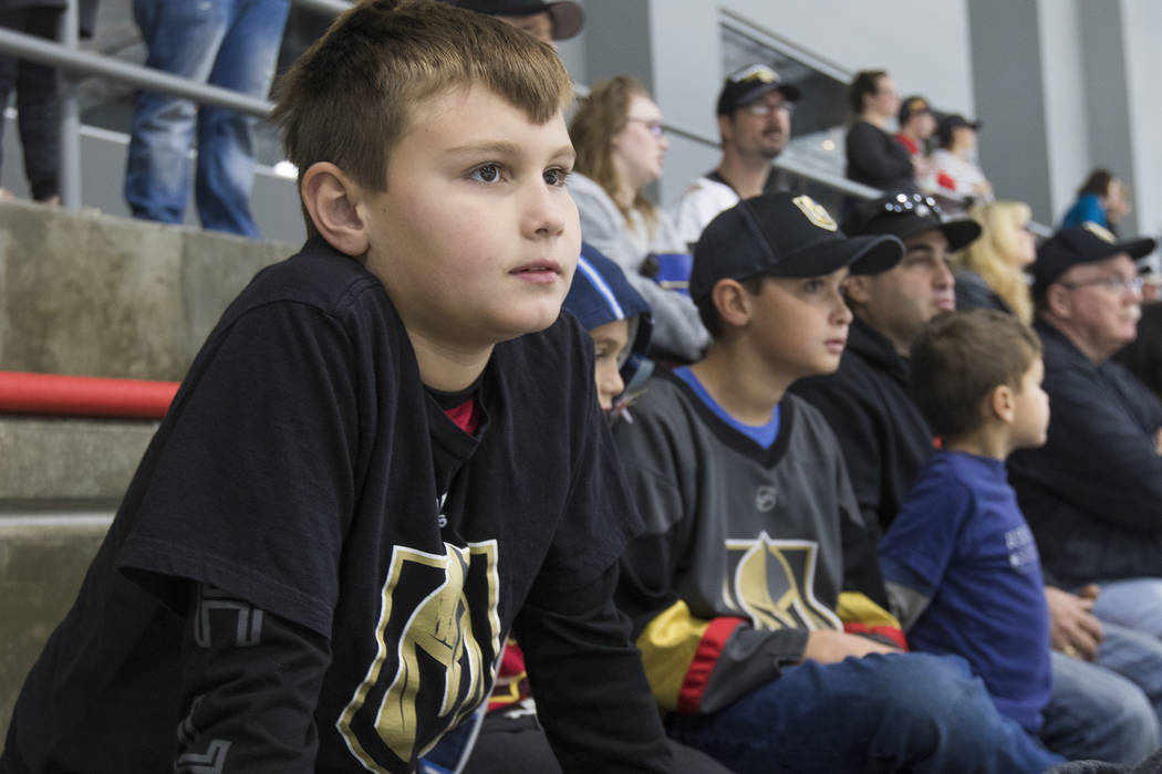 Mason Leoncavallo, 9, watches the Vegas Golden Knights practice alongside his brothers Tatem Leoncavallo, 7, Trevor Leoncavallo, 11, and Logan Leoncavallo, 6, and his dad Victor Leoncavallo at the ...
