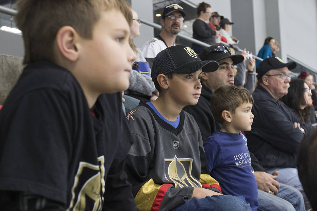 Mason Leoncavallo, 9, watches the Vegas Golden Knights practice alongside his brothers Trevor Leoncavallo, 11, and Logan Leoncavallo, 6, and his dad Victor Leoncavallo at the City National Arena i ...