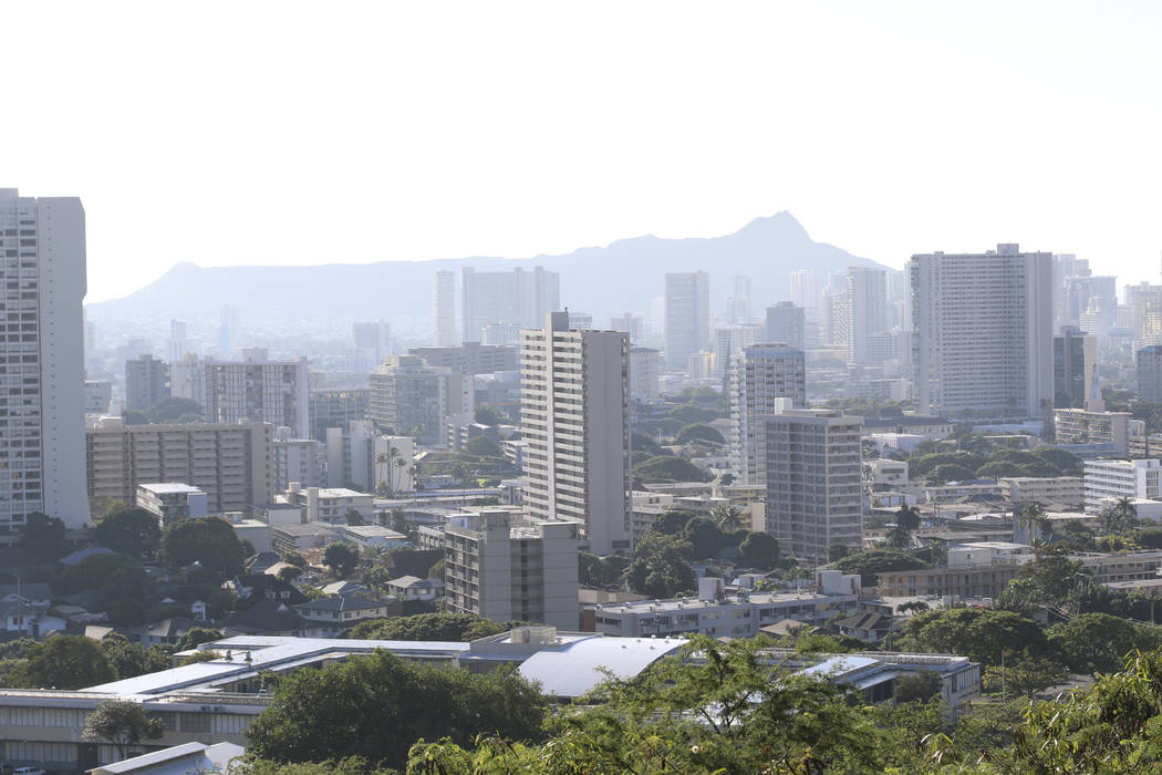 Diamond Head, an extinct volcanic crater, and high-rises are seen in Honolulu on Saturday, Jan. 13, 2018. A push alert that warned of an incoming ballistic missile to Hawaii and sent residents int ...