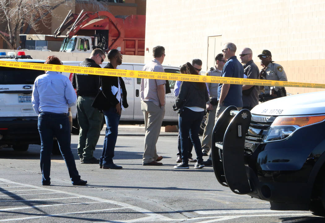 Las Vegas police investigate after a woman was shot in front of a checking cashing store near Jones and Vegas Drive on Thursday, Jan. 11, 2018, in Las Vegas. Bizuayehu Tesfaye/Las Vegas Review-Jou ...