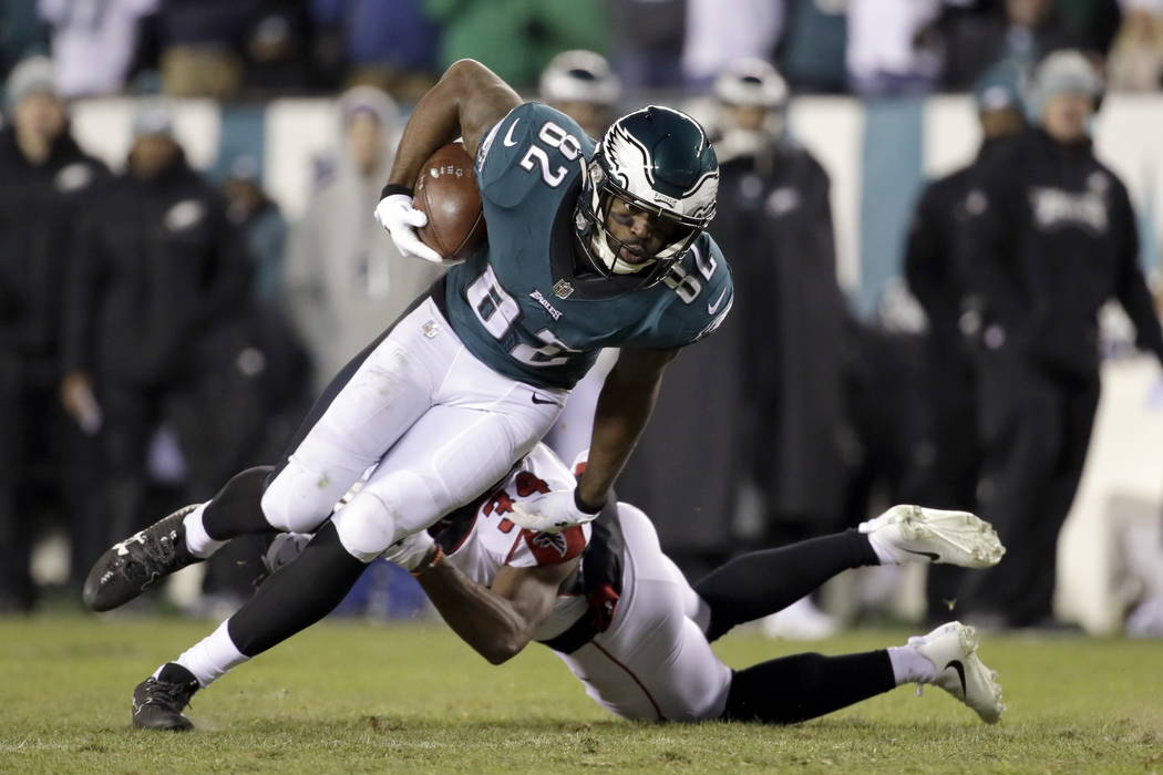 Philadelphia Eagles' Torrey Smith, left, tries to slip past Atlanta Falcons' Brian Poole during the second half of an NFL divisional playoff football game, Saturday, Jan. 13, 2018, in Philadelphia ...