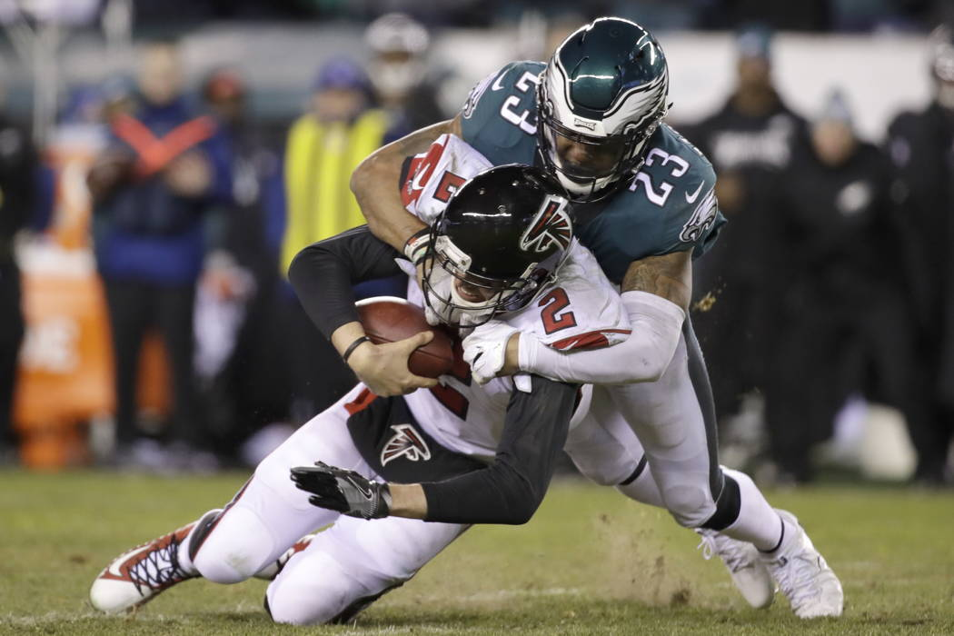Philadelphia Eagles' Rodney McLeod (23) tackles Atlanta Falcons' Matt Ryan (2) during the second half of an NFL divisional playoff football game, Saturday, Jan. 13, 2018, in Philadelphia. (AP Phot ...