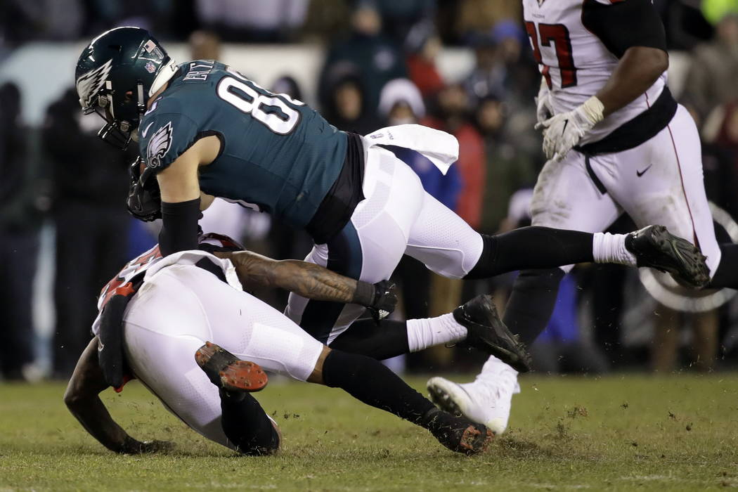 Philadelphia Eagles' Zach Ertz, top, is tackled by Atlanta Falcons' Ricardo Allen during the second half of an NFL divisional playoff football game, Saturday, Jan. 13, 2018, in Philadelphia. (AP P ...