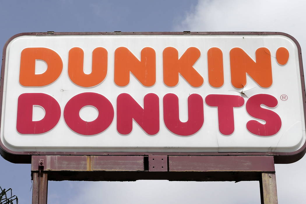 A Dunkin' Donuts sign is seen at a store in Hialeah, Fla. (AP Photo/Alan Diaz)