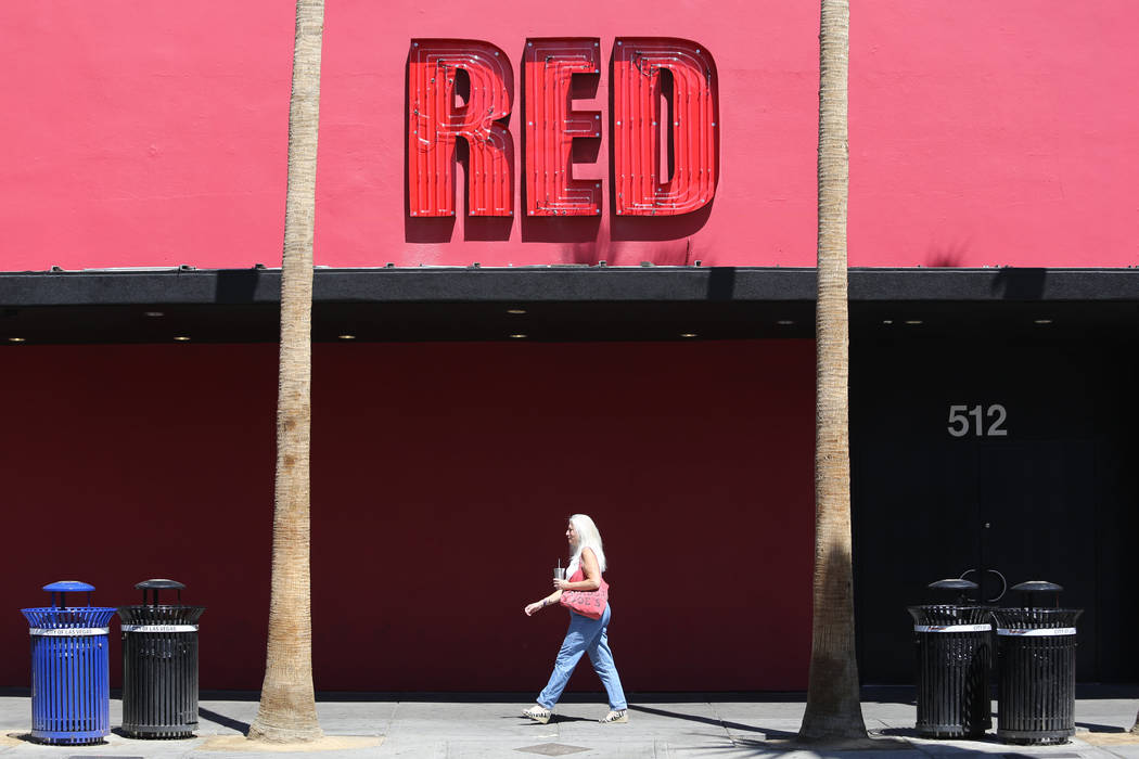 A woman passes in front of Red on Fremont Street in Las Vegas in 2016. (Las Vegas Review-Journal)