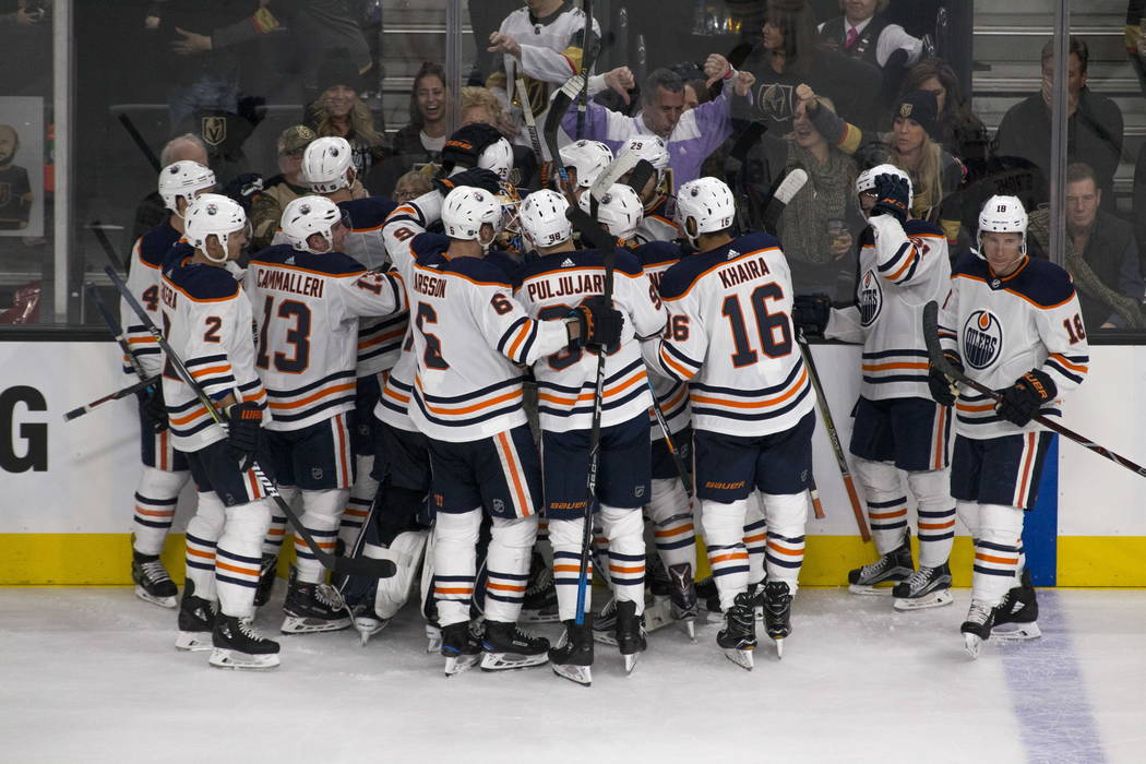 The Edmonton Oilers celebrate their 3-2 overtime victory over the Vegas Golden Knights at T-Mobile Arena in Las Vegas, Saturday, Jan. 13, 2018. Richard Brian Las Vegas Review-Journal @vegasphotograph