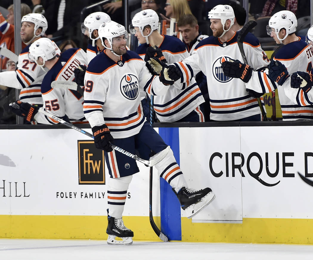 Edmonton Oilers left wing Patrick Maroon (19) celebrates with his teammates after scoring a goal against the Vegas Golden Knights during the second period of an NHL hockey game Saturday, Jan. 13,  ...