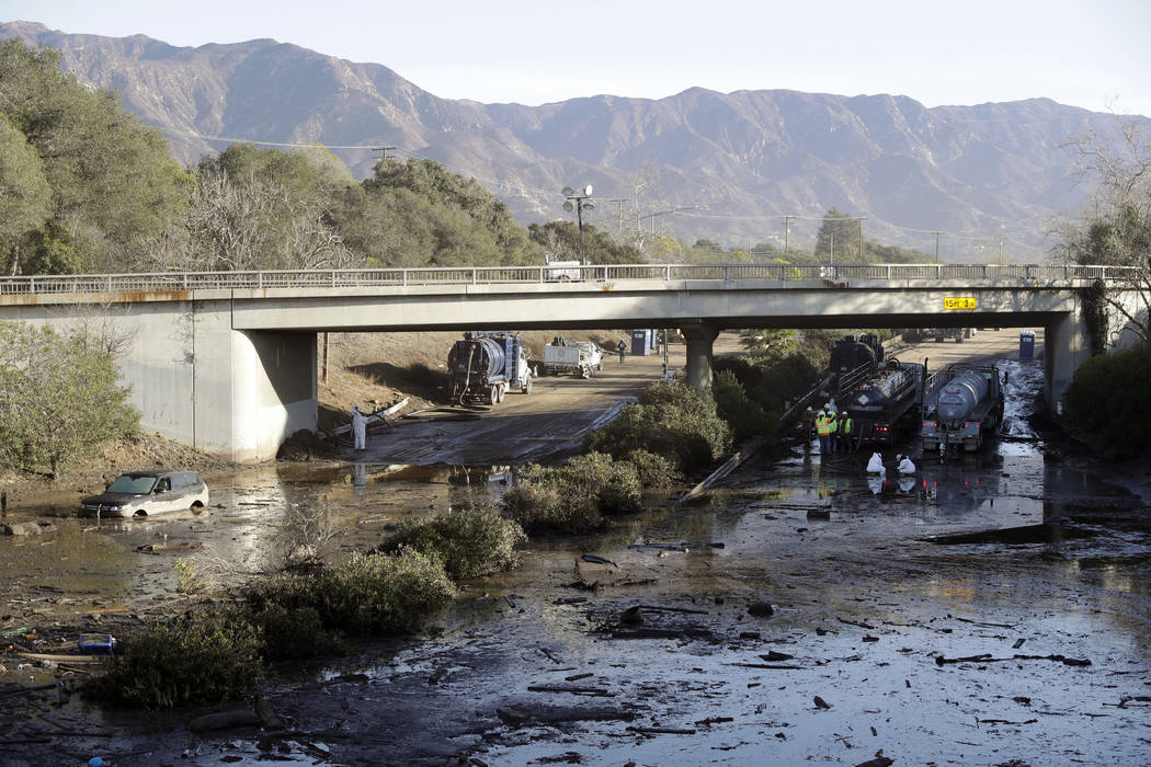 Crews work on clearing Highway 101 in the aftermath of a mudslide Saturday, Jan. 13, 2018, in Montecito, Calif. Most of the people of Montecito, a town usually known for its serenity and luxury, w ...