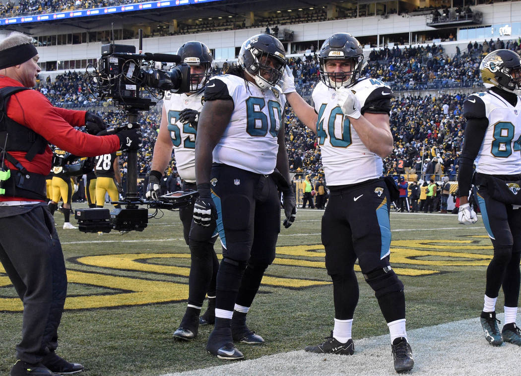 Jacksonville Jaguars fullback Tommy Bohanon (40) celebrates his touchdown during the second half of an NFL divisional football AFC playoff game against the Pittsburgh Steelers in Pittsburgh, Sunda ...