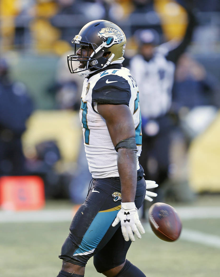 Jacksonville Jaguars running back Leonard Fournette (27) celebrates his touchdown during the second half of an NFL divisional football AFC playoff game against the Pittsburgh Steelers in Pittsburg ...