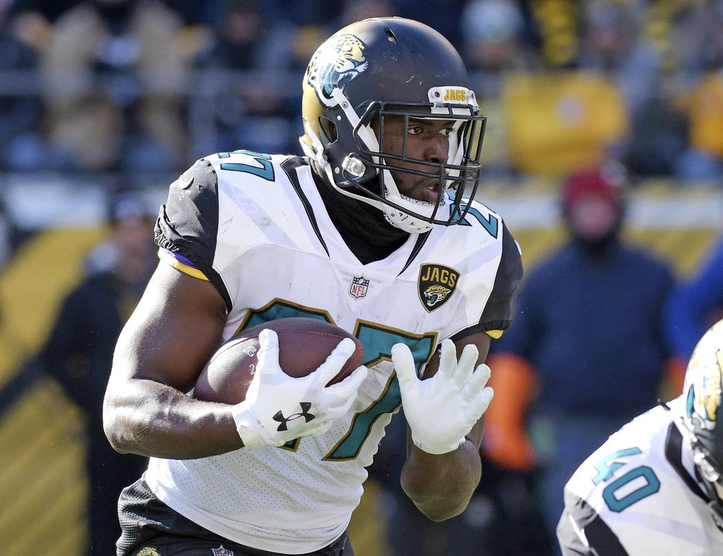 Jacksonville Jaguars running back Leonard Fournette (27) carries the ball during the first half of an NFL divisional football AFC playoff game against the Pittsburgh Steelers in Pittsburgh, Sunday ...