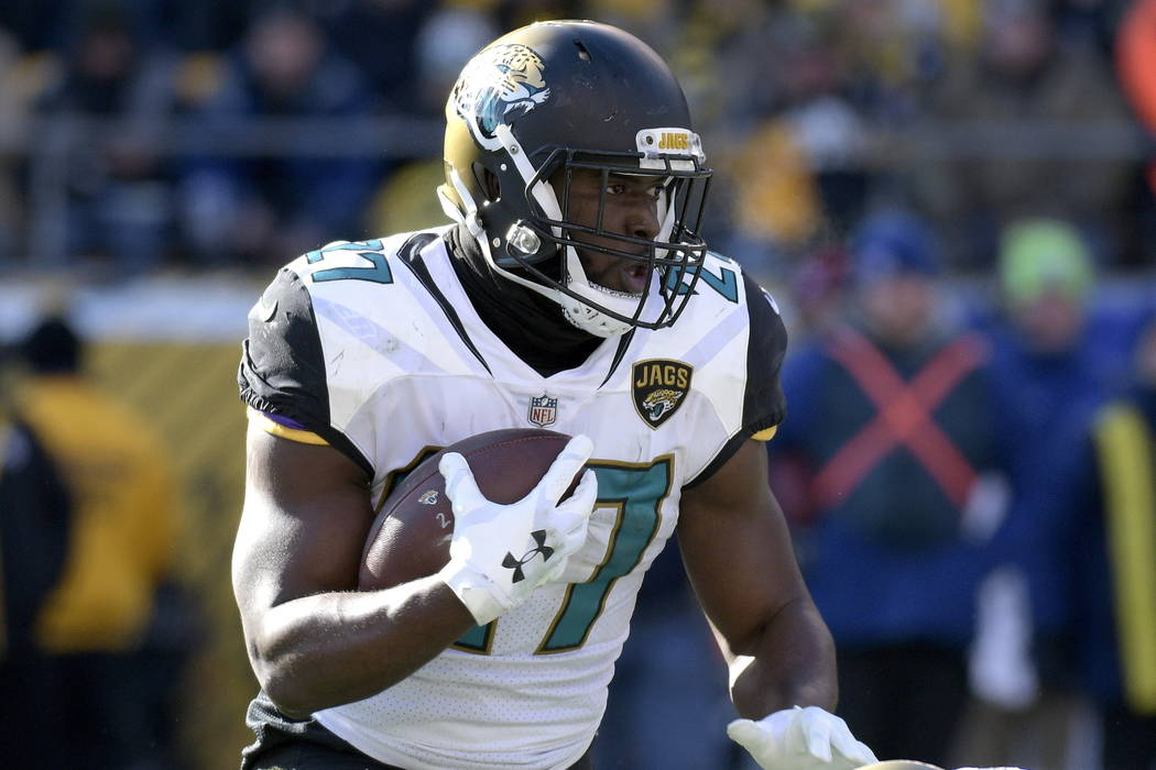 Jacksonville Jaguars running back Leonard Fournette runs the ball against the Pittsburgh Steelers during the first half of an NFL divisional football AFC playoff game in Pittsburgh, Sunday, Jan. 1 ...