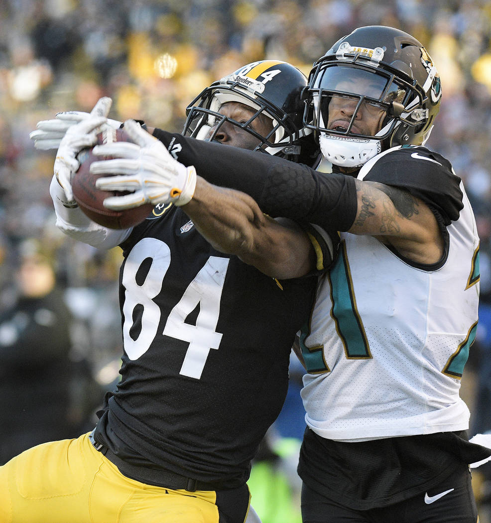 Pittsburgh Steelers wide receiver Antonio Brown (84) catches a pass from quarterback Ben Roethlisberger for a touchdown with Jacksonville Jaguars cornerback A.J. Bouye (21) defending during the se ...