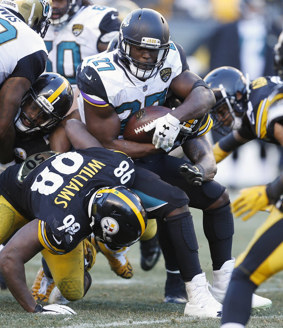 Jacksonville Jaguars running back Leonard Fournette (27) tries to get past Pittsburgh Steelers inside linebacker Vince Williams (98) during the second half of an NFL divisional football AFC playof ...