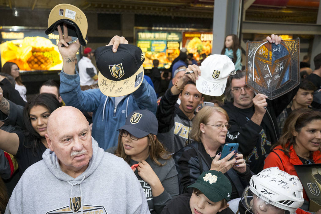 Vegas Golden Knights wait for autographs during the team's first fan fest at the Fremont Street Experience in downtown Las Vegas on Sunday, Jan. 14, 2018. Richard Brian Las Vegas Review-Journal @v ...