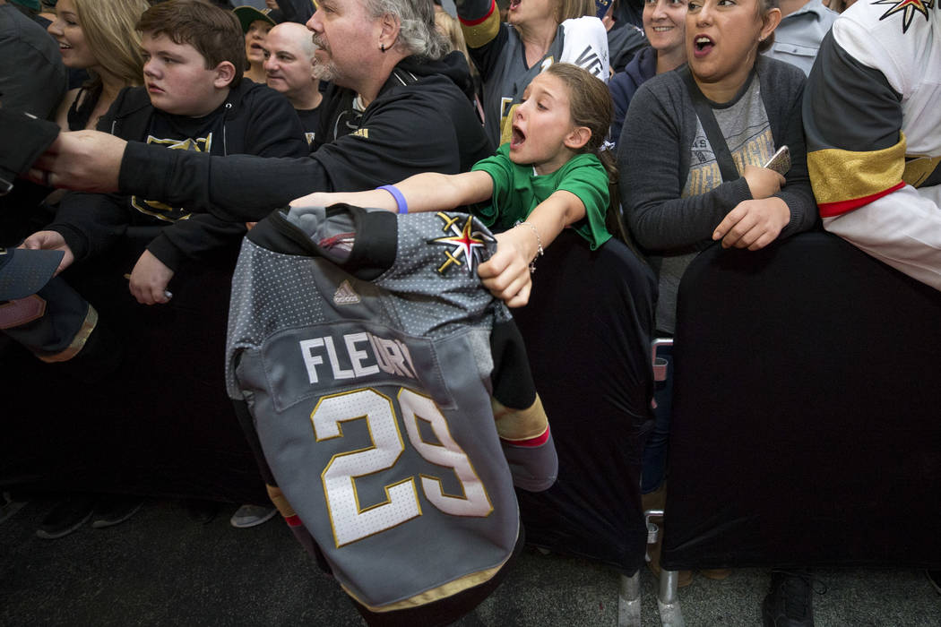 Henderson resident Isabella Lewis, 9, screams for Vegas Golden Knights goaltender Marc-Andre Fleury during the team's first fan fest at the Fremont Street Experience in downtown Las Vegas on Sunda ...