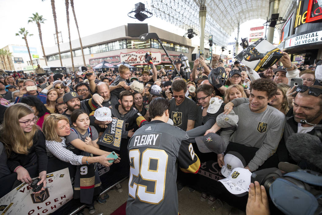 Vegas Golden Knights goaltender Marc-Andre Fleury (29) signs autographs during the team's first fan fest at the Fremont Street Experience in downtown Las Vegas on Sunday, Jan. 14, 2018. Richard Br ...