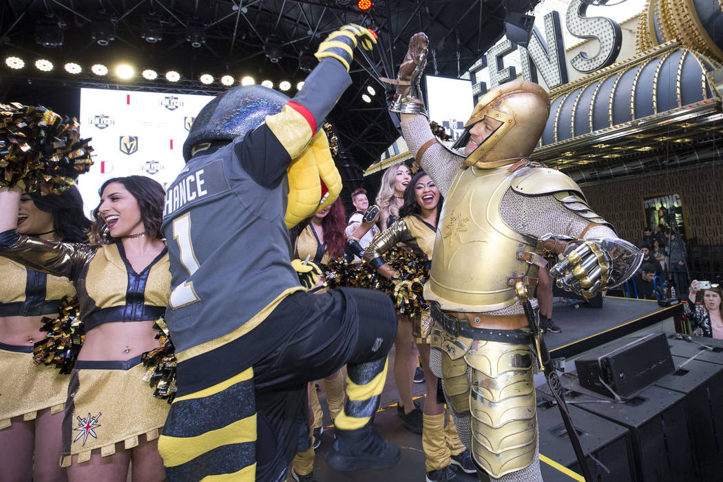 Chance the Golden Gila Monster, left, and the Golden Knight hype the crowd during the team's first fan fest at the Fremont Street Experience in downtown Las Vegas on Sunday, Jan. 14, 2018. Richard ...
