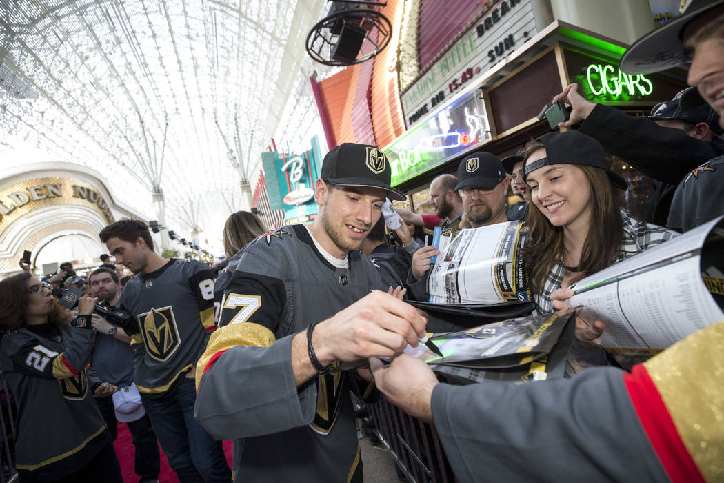 Vegas Golden Knights defenseman Shea Theodore (27) signs autographs during the team's first fan fest at the Fremont Street Experience in downtown Las Vegas on Sunday, Jan. 14, 2018. Richard Brian  ...