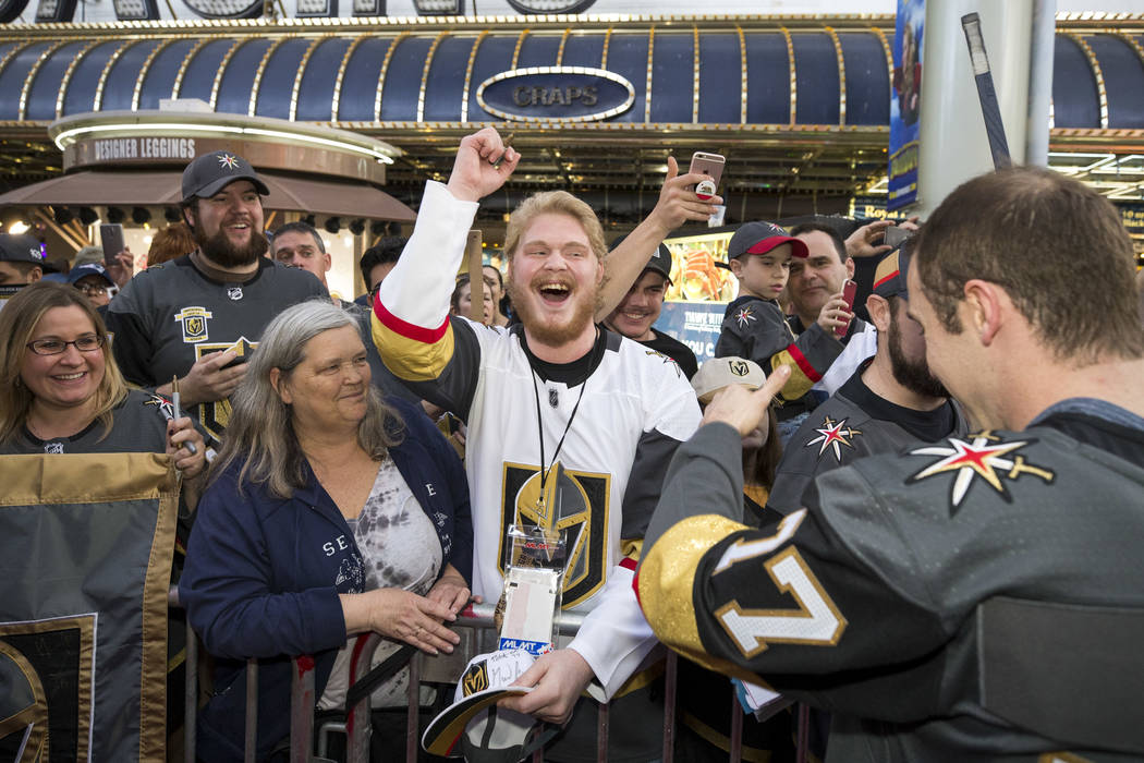 Vegas Golden Knights fans cheers for Knights defenseman Brad Hunt (77) during the team's first fan fest at the Fremont Street Experience in downtown Las Vegas on Sunday, Jan. 14, 2018. Richard Bri ...