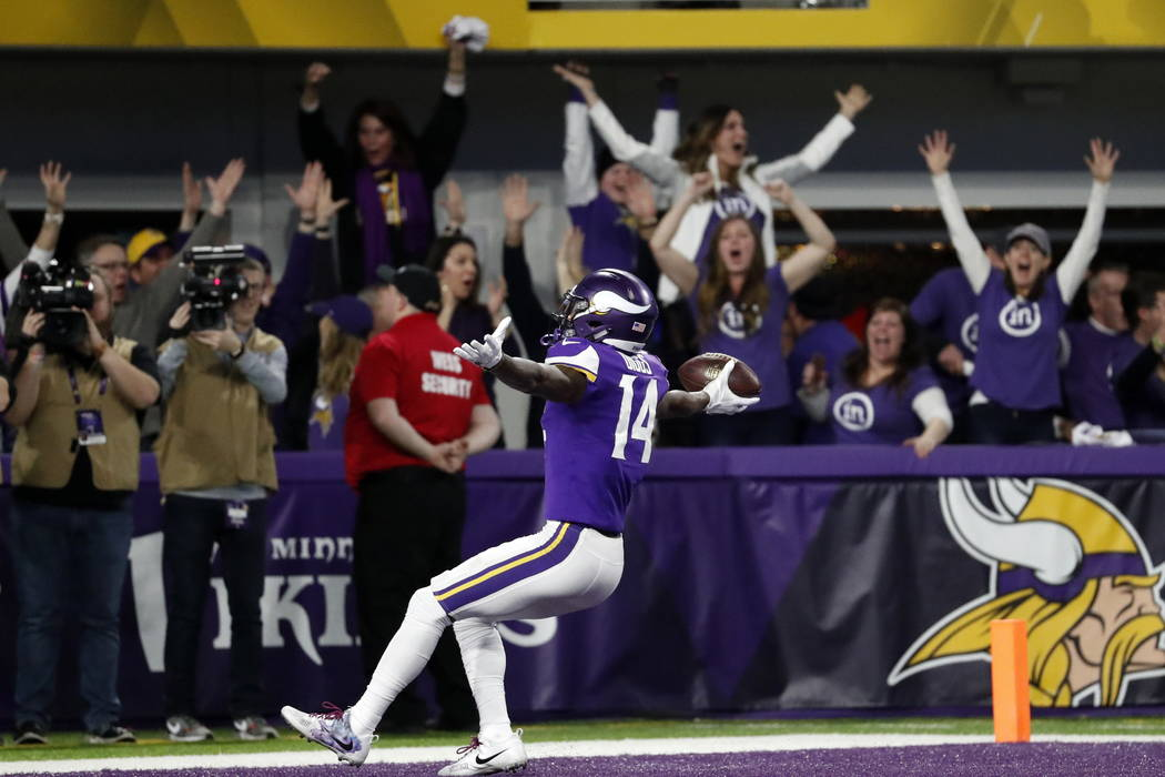 Minnesota Vikings wide receiver Stefon Diggs (14) runs in for a game winning touchdown against the New Orleans Saints during the second half of an NFL divisional football playoff game in Minneapol ...