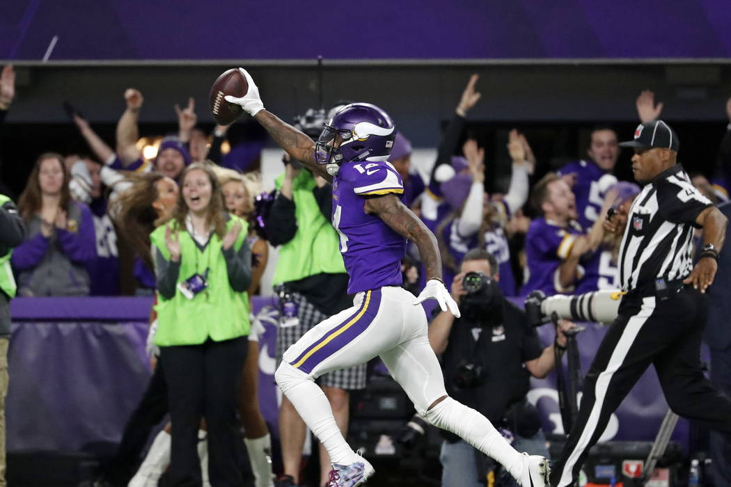 Minnesota Vikings wide receiver Stefon Riggs (14) runs in for a game winning touchdown against the New Orleans Saints during the second half of an NFL divisional football playoff game in Minneapol ...