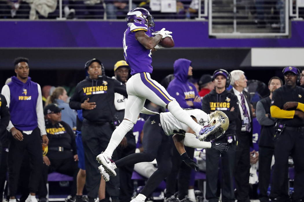 Minnesota Vikings wide receiver Stefon Riggs (14) makes a catch over New Orleans Saints free safety Marcus Williams (43) on his way to the game winning touchdown during the second half of an NFL d ...