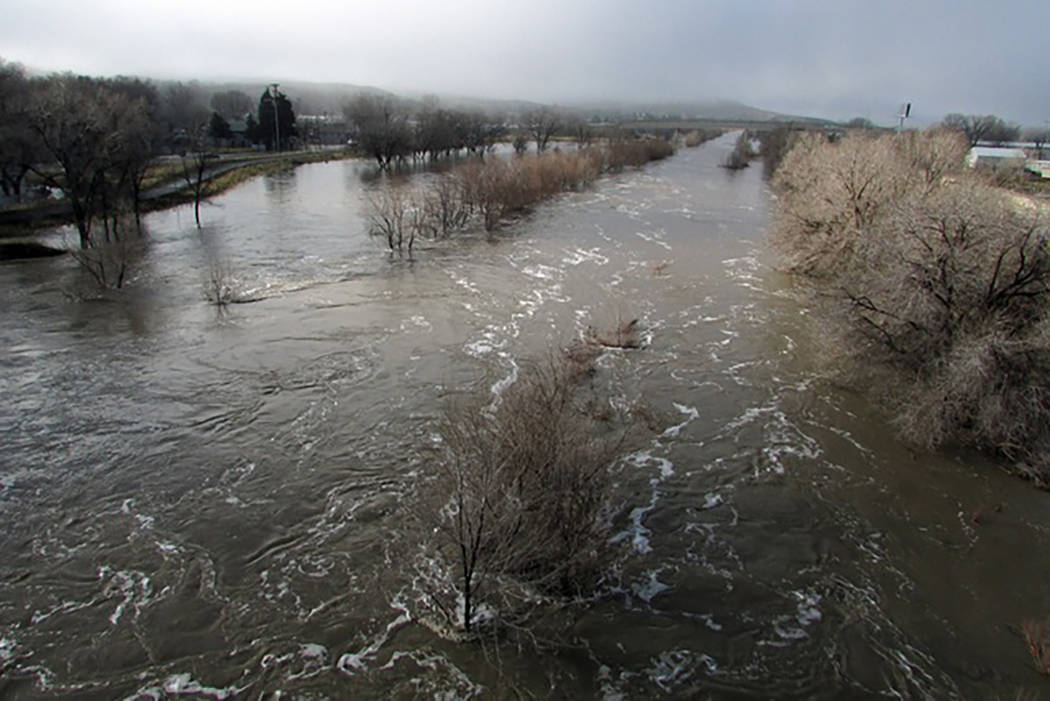 The Humboldt River is swollen far beyond its normally narrow channel through Elko on Saturday, February 11, 2017. (Jeff Mullins/ The DailyFree Press via AP)