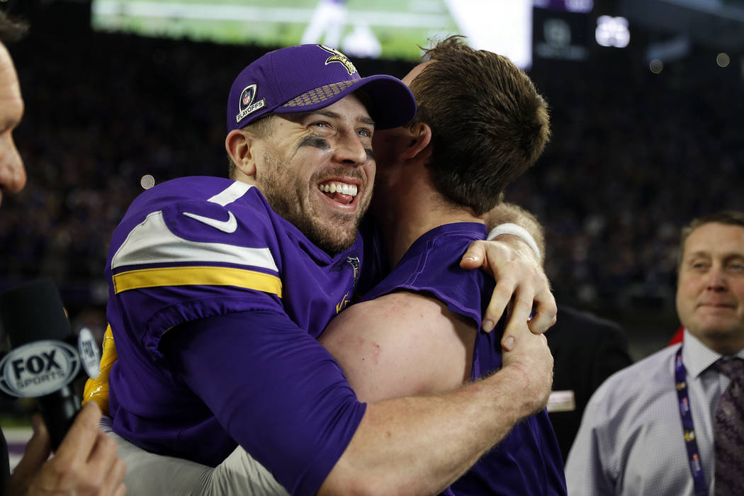 Minnesota Vikings quarterback Case Keenum, left, celebrates after a 29-24 win over the New Orleans Saints during the second half of an NFL divisional football playoff game in Minneapolis, Sunday,  ...